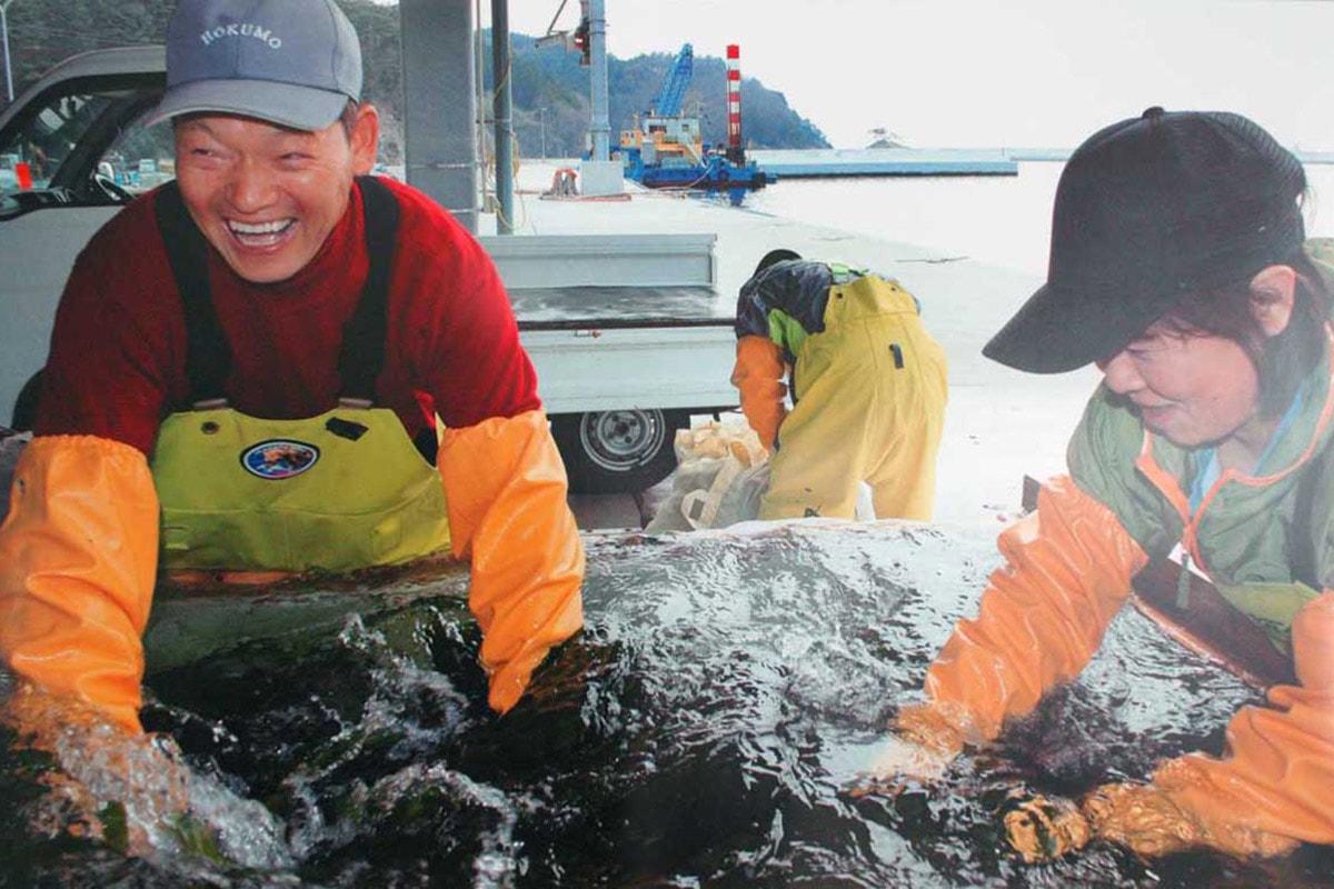 金賞を受賞した木村明子さん(中妻町)の写真「浜の笑顔」
