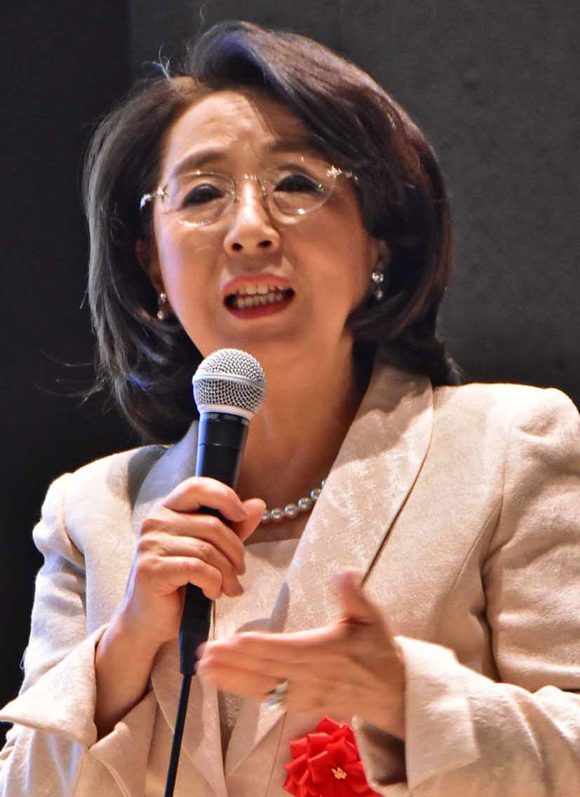 講演する慶応大の米田特任教授